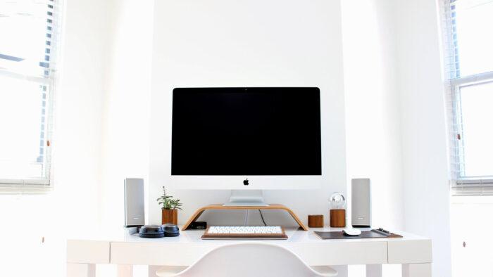 simple white organized workspace setting zoom virtual background